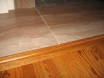 come accostare pavimenti diversi marmo parquet