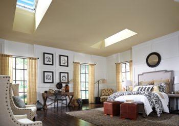 Finestra per tetti piani Velux in camera da letto